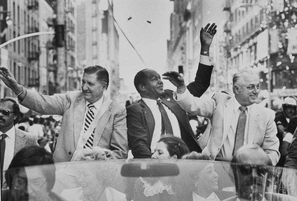 Al Campanis, left, vice president of player personnel for the Los Angeles Dodgers is joined by Mayor Tom Bradley and Dodgers manager Tom Lasorda during Dodger Day parade through the streets of Los Angeles, Oct. 31, 1981. More than 300,000 person lined the city sidewalks to acknowledge their appreciation of the 1981 World Series champions. (AP Photo/Randy Rasmussen)