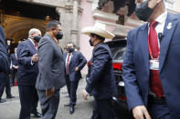 President-elect Pedro Castillo arrives in his signature hat to the Foreign Ministry before going to Congress for his swearing-in ceremony on his Inauguration Day in Lima, Peru, Wednesday, July 28, 2021. (AP Photo/Guadalupe Pardo)