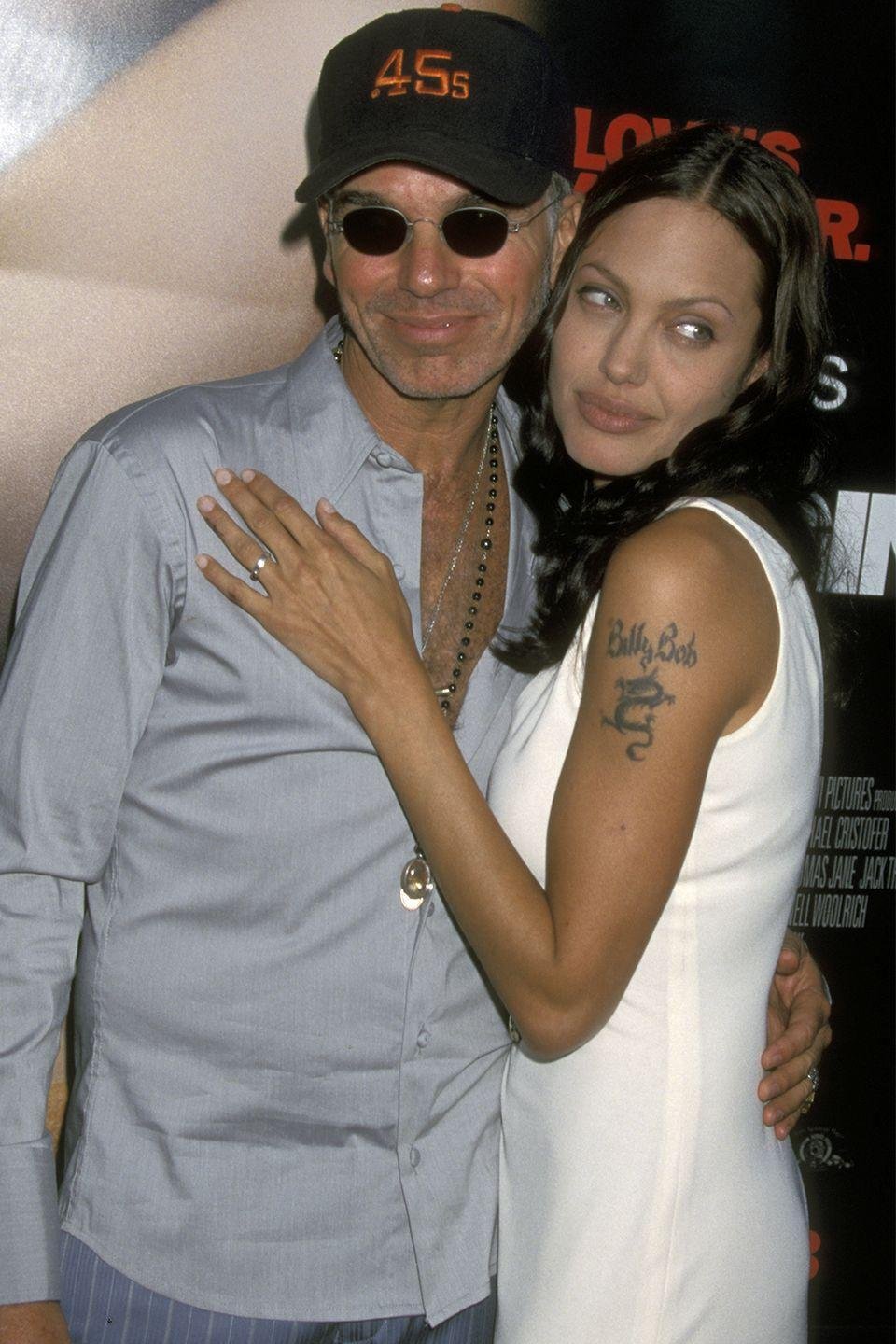 """<p>Remember that time Angelina Jolie and Billy Bob Thornton were a thing? And when she had his name tattooed on her arm above a dragon? Well, after they were divorced in 2003, Jolie decided she no longer wanted """"Billy Bob"""" on her body. </p><p>""""I never felt good enough for her,"""" Thornton later said in an interview with <a href=""""https://www.gq.com/story/billy-bob-thornton-bad-santa-2-profile"""" rel=""""nofollow noopener"""" target=""""_blank"""" data-ylk=""""slk:GQ"""" class=""""link rapid-noclick-resp""""><em>GQ</em></a>. """"I'm real uncomfortable around rich and important people.""""<br></p>"""