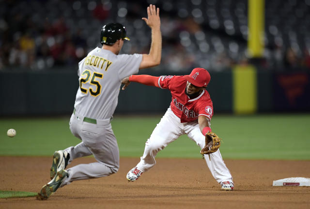 Oakland Athletics' Stephen Piscotty, left, makes it to second on a wild pitch as Los Angeles Angels second baseman Luis Rengifo misses the throw from home during the fourth inning of a baseball game Thursday, June 6, 2019, in Anaheim, Calif. (AP Photo/Mark J. Terrill)
