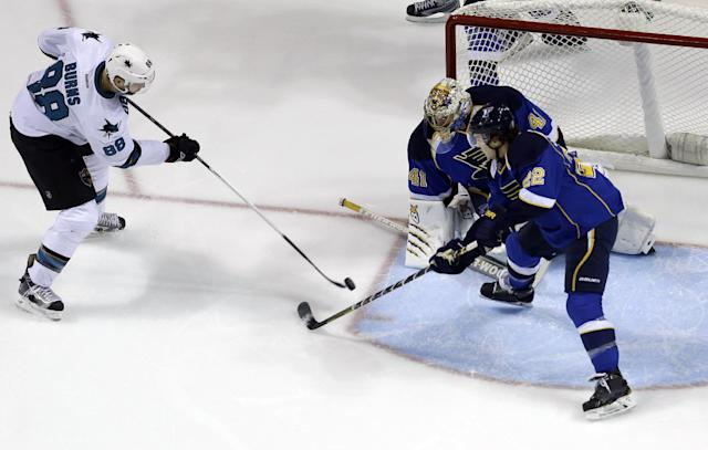 San Jose Sharks' Brent Burns (88) scores past St. Louis Blues goalie Jaroslav Halak, of Slovakia, and Kevin Shattenkirk (22) during the second period of an NHL hockey game Tuesday, Dec. 17, 2013, in St. Louis. (AP Photo/Jeff Roberson)