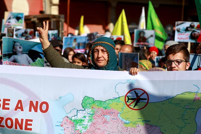 A Syrian Kurdish woman flashes the V-sign for victory during a demonstration in Qamishli on January 20, 2019, marking the first anniversary of the takeover of the northern Syrian city of Afrin by the Turkish army and allied Syria fighters (AFP Photo/Delil SOULEIMAN)