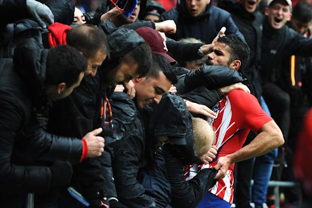 Diego Costa celebrates with Atletico Madrid fans after scoring in his first La Liga match back with the Spanish club. (Getty)