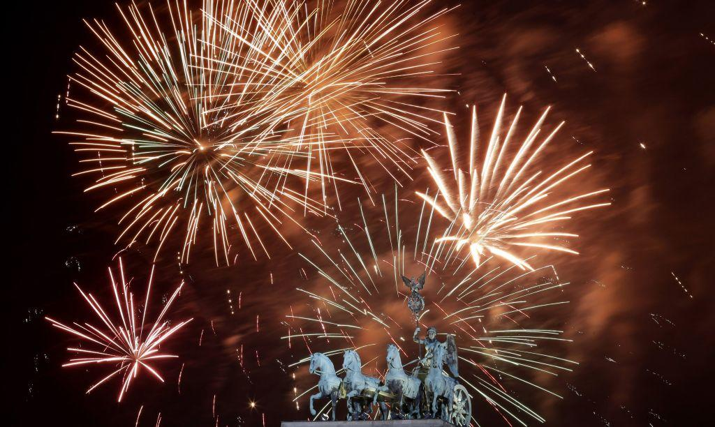 Fireworks explode during New Year celebrations over the Brandenburger Tor gate in Berlin January 1, 2013.