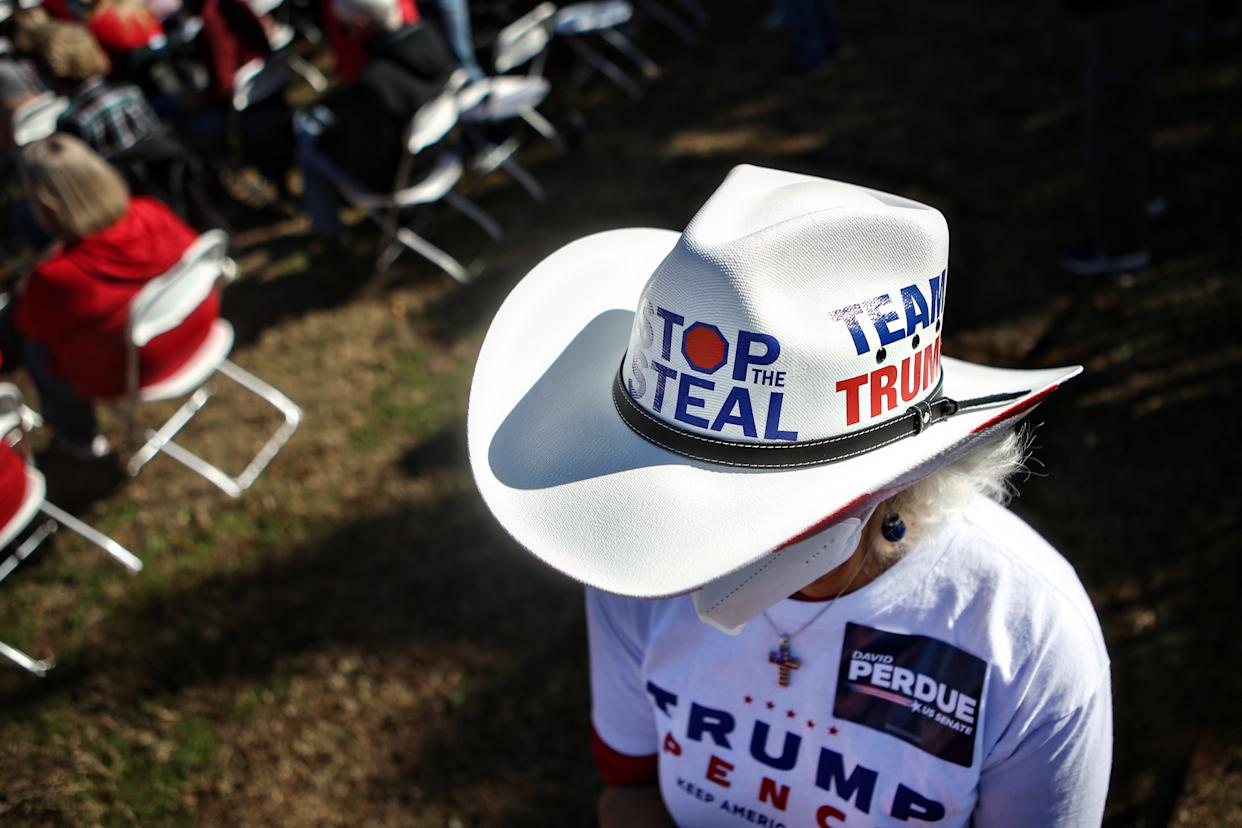 A Republican supporter wearing a Stop the Steal hat attends the Defend the Majority Rally in support of Sen. David Perdue (R-GA) and Sen. Kelly Loeffler (R-GA). (Jason Armond / Los Angeles Times via Getty Images)