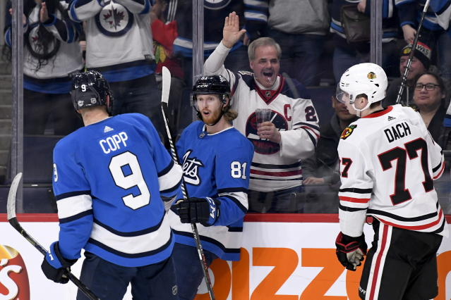 Winnipeg Jets' Kyle Connor (81) celebrates his short-handed goal against the Chicago Blackhawks with Andrew Copp (9) during second period NHL hockey action in Winnipeg, Manitoba on Sunday, Feb. 9, 2020. (Fred Greenslade/The Canadian Press via AP)