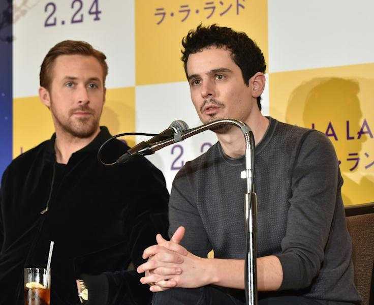 "The festival kicks off with ""First Man"", with Chazelle (R) teaming up with his ""La La Land"" star Gosling (L)"