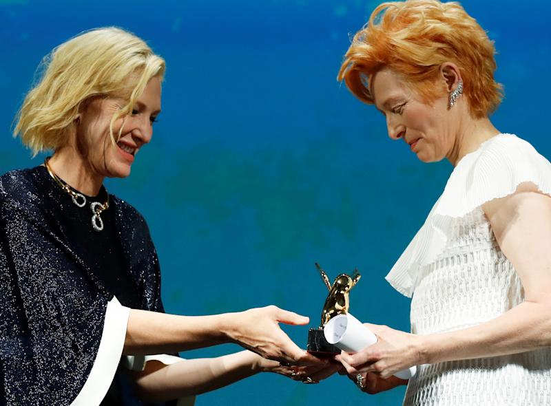 The 77th Venice Film Festival - Opening Ceremony - Venice, Italy, September 2, 2020 - Actor Tilda Swinton receives a Golden Lion statuette from President of the jury Cate Blanchett as an award for lifetime achievement . REUTERS/Yara Nardi