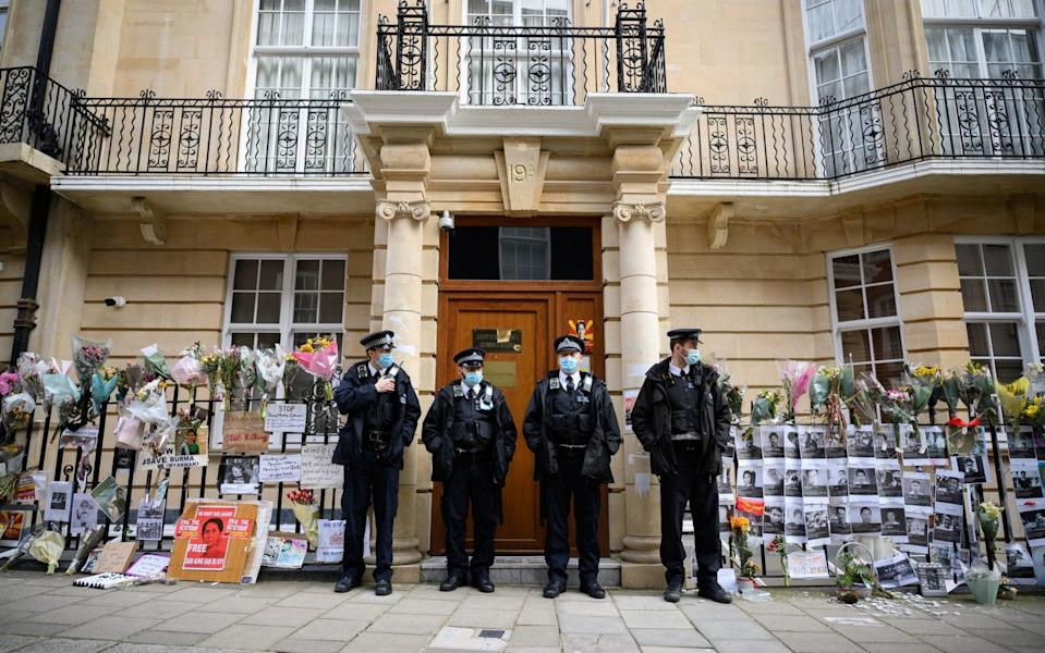 Police officers stand guard after former Myanmar Ambassador to the UK Kyaw Zwar Minn was locked out  - Leon Neal /Getty Images Europe