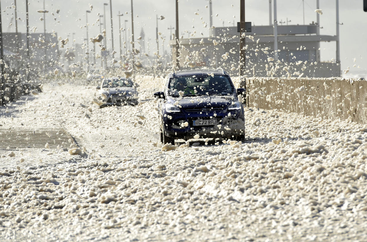 <p>High winds and foam spraying from the sea making driving conditions difficult in Cleveleys, Lancashire, and weather warnings are still in place for much of the UK. (SWNS) </p>