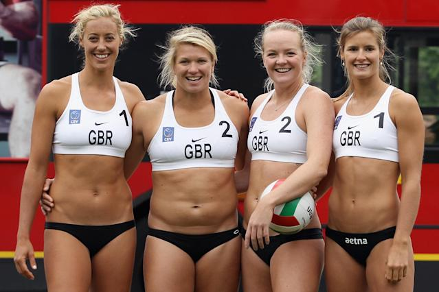 LONDON, ENGLAND - MAY 24: Members of Great Britain women's Beach Volleyball team (L-R) Denise Johns, Lucy Bolton, Shauna Mullin and Zara Dempne take part in a 'Stop Traffic' photocall on Parliament Square on May 24, 2012 in London, England. The PR stunt was aimed at reminding commuters that roads were likely to be busier at peak times during the 2012 London Olympic Games. (Photo by Dan Kitwood/Getty Images)