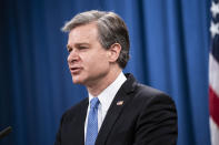 FBI Director Christopher Wray speaks during a virtual news conference at the Department of Justice, Wednesday, Oct. 28, 2020 in Washington. The Justice Department has charged eight people with working on behalf of the Chinese government to locate Chinese dissidents and political opponents living in the U.S. and coerce them into returning to China. Five of the eight were arrested Wednesday morning. (Sarah Silbiger/Pool via AP)