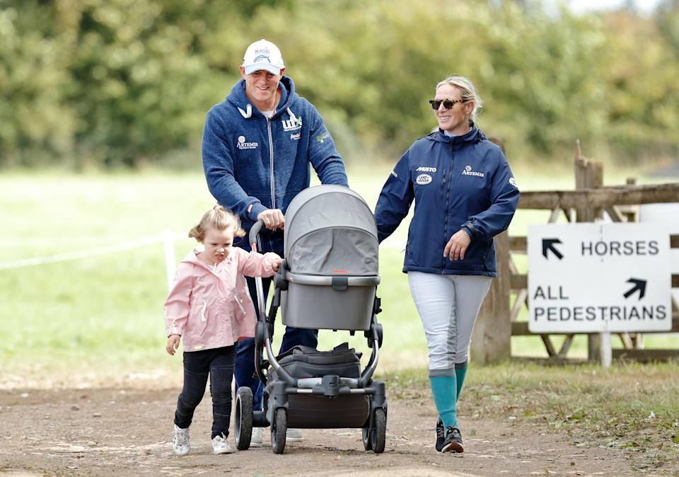 STROUD, UNITED KINGDOM - SEPTEMBER 09: (EMBARGOED FOR PUBLICATION IN UK NEWSPAPERS UNTIL 24 HOURS AFTER CREATE DATE AND TIME) Mike Tindall and Zara Tindall with their daughters Mia Tindall and Lena Tindall (in her pram) attend day 3 of the Whatley Manor Horse Trials at Gatcombe Park on September 9, 2018 in Stroud, England. (Photo by Max Mumby/Indigo/Getty Images)