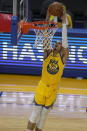 Golden State Warriors forward Juan Toscano-Anderson (95) dunks against the Sacramento Kings during the first half of an NBA basketball game on Sunday, April 25, 2021, in San Francisco. (AP Photo/Tony Avelar)