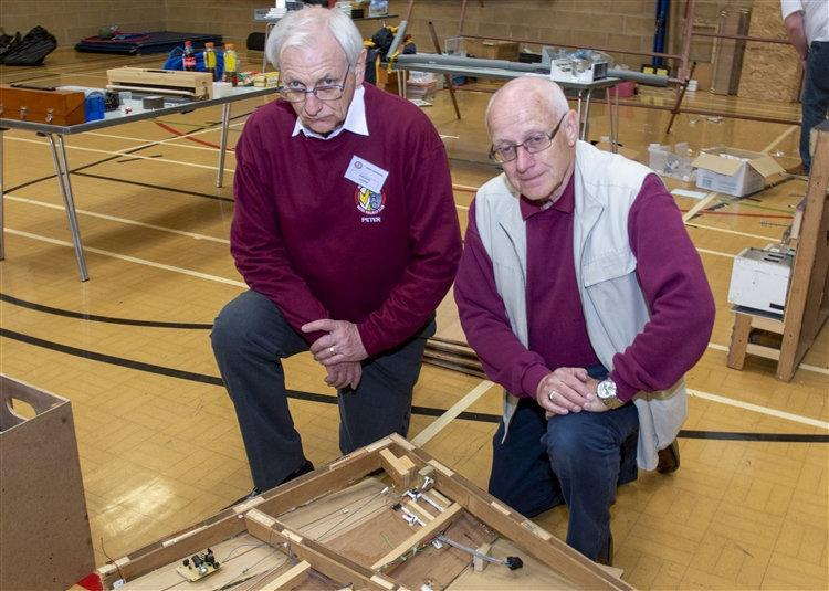 Years of work destroyed: Members of the Market Deeping Model Railway Club after the exhibition was devastated. (SWNS)