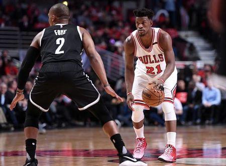 Apr 12, 2017; Chicago, IL, USA; Chicago Bulls forward Jimmy Butler (21) dribbles the ball against Brooklyn Nets guard Randy Foye (2) during the second half at the United Center. Chicago defeats Brooklyn 112-73. Mandatory Credit: Mike DiNovo-USA TODAY Sports