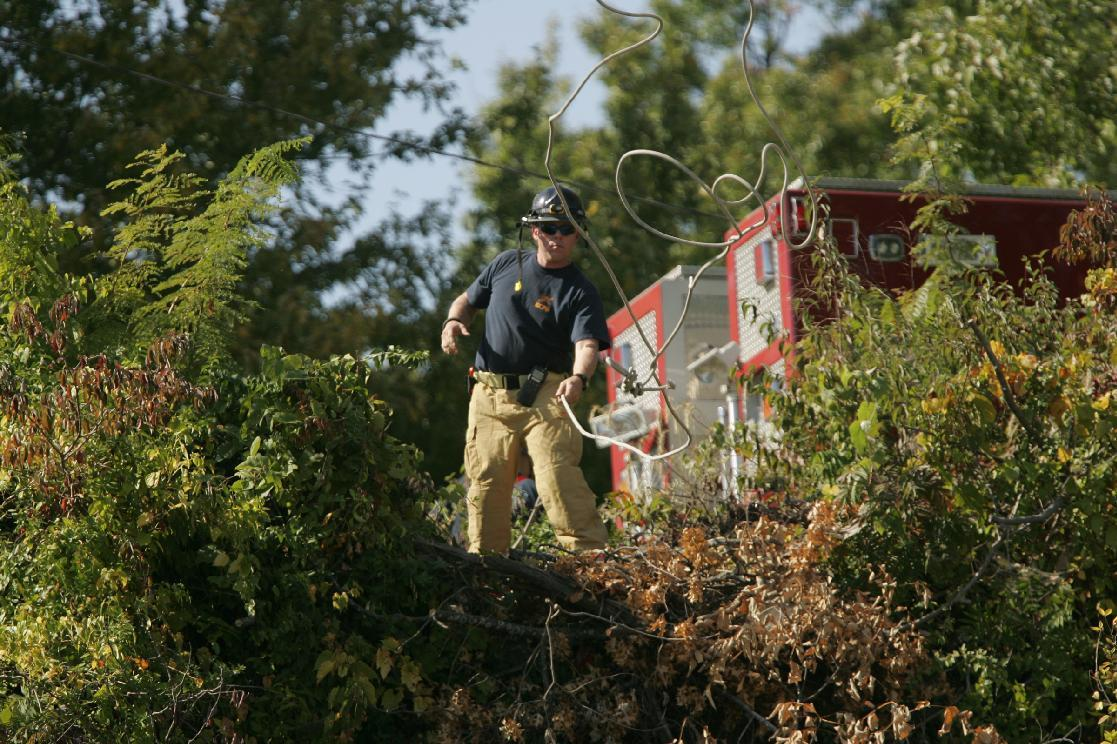 Kansas City Missouri Fire Department Rescue Technicians used repelling equipment as they search a wooded area for missing 10-month-old Lisa Irwin in Kansas City, Mo. Tuesday, Oct. 4, 2011. Irwin was presumably abducted overnight from her Kansas City home by an intruder who climbed through a bedroom window, authorities said. (AP Photo/The Kansas City Star, Mike Ransdell)