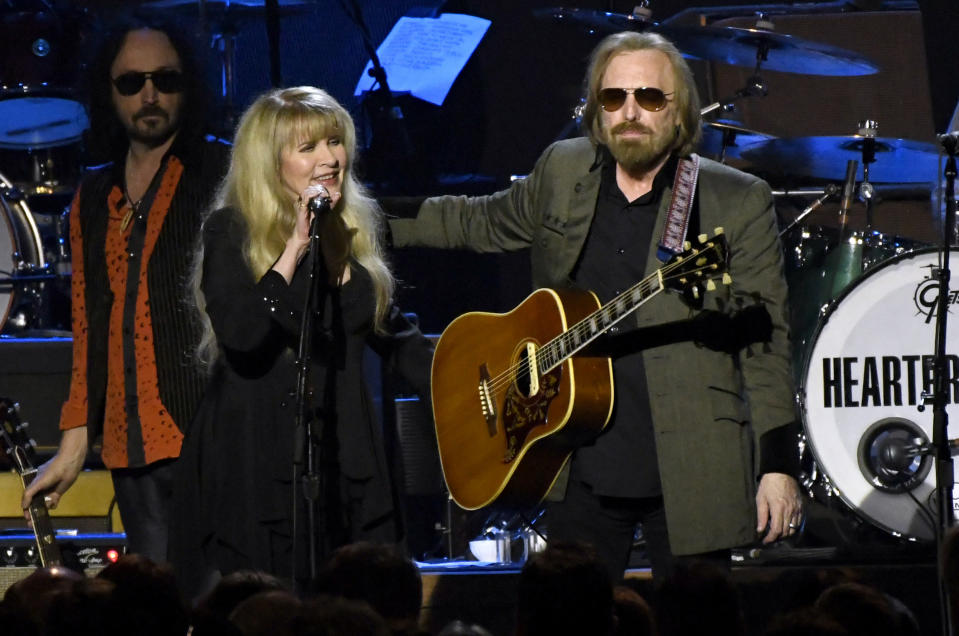 """FILE - Stevie Nicks, left, and honoree Tom Petty perform at the MusiCares Person of the Year tribute in Los Angeles on Feb. 10, 2017. Just months before Petty died, the pair got together at the British Summer Time at Hyde Park in London to perform their 1981 hit """"Stop Draggin' My Heart Around."""" (Photo by Chris Pizzello/Invision/AP, File)"""