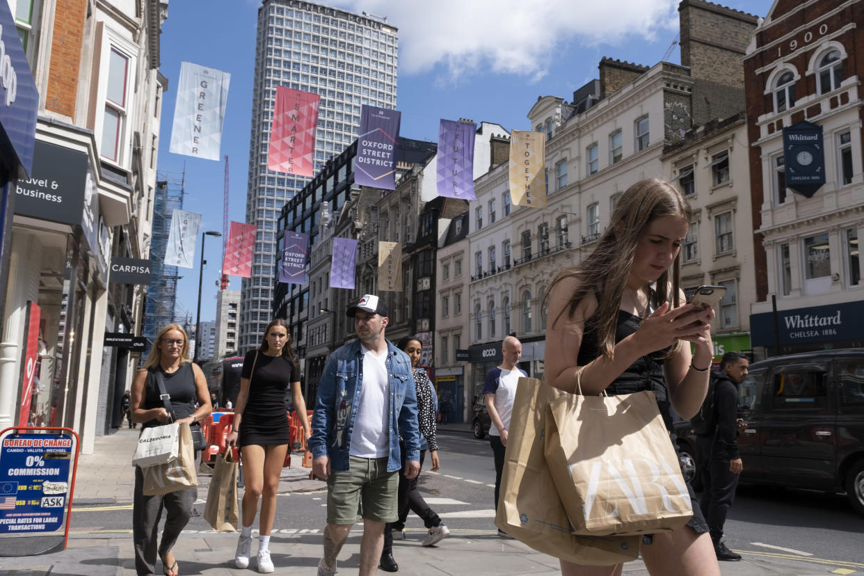 Now that most restrictions have come to an end, Oxford Street shopping district is busier than much of the last 18 months as shoppers return in their droves and retail business looks set to bounce back on 10th August 2021 in London, United Kingdom. Many people are wearing face masks in crowded places like this but they are no longer mandatory, while government advice suggests that it is advised to wear a face covering in busy public places inside and on transport, many people are still wearing them outside. (photo by Mike Kemp/In Pictures via Getty Images)