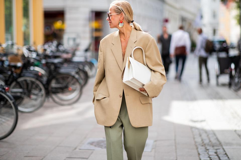 """<p>The bigger the better, am I right? The oversized, boxy, menswear blazer has taken over the runway and become a street style favorite. Blazers aren't just <a href=""""https://www.marieclaire.com/fashion/g31677975/work-blazers/"""" rel=""""nofollow noopener"""" target=""""_blank"""" data-ylk=""""slk:for the office"""" class=""""link rapid-noclick-resp"""">for the office</a> anymore and are <em>the</em> new springtime coat of choice. A classic blazer is a wardrobe essential—just about everyone has some version hanging in their closet—but for spring 2020, the traditional fitted blazer can take a step back, as designers like Jacquemus, Tibi, Proenza Schouler and The Row are giving the blazer a new direction with a loose boxy fit, long sleeves and padded shoulders. This menswear silhouette can easily be given a feminine edge, and some of our favorite street style stars are showing us how it's done. From adding a printed trouser to showing a little skin to even adding elements of sportswear, there are a variety of ways to pull this here-to-stay trend off, no matter what your personal style may be. Below, we've <em>blazed</em> through countless shopping sites for you to bring you the best options to buy now.</p>"""