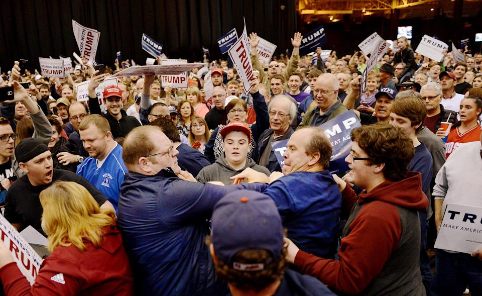 A protester and Trump supporter scuffle during a rally for then-presidential candidate Donald Trump on March, 12, 2016, at I-X Arena in Cleveland.