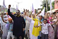 Punjabi actor Hardeep Gill and Punjabi actress Anita Devgun along with farmers and their family members shout slogans during Punjab bandh, a statewide farmers' strike against the recent passing of agriculture bills in the Parliament, on September 25, 2020 in Amritsar, India. The two bills - the Farmers (Empowerment and Protection) Agreement on Price Assurance and Farm Services Bill, 2020 and the Farming Produce Trade and Commerce (Promotion and Facilitation) Bill, 2020 - were passed by the Rajya Sabha despite uproar and strong protest by the Opposition parties in the house. (Photo by Sameer Sehgal/Hindustan Times via Getty Images)