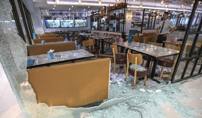 Glass panels at FL Fusion restaurant, under the Fulum Group, smashed by radical protesters in Sha Tin. Photo: Felix Wong