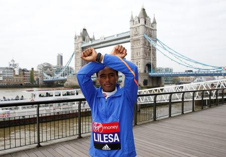 FILE PHOTO: Britain Athletics - London Marathon Previews - London - 20/4/17 Feyisa Lilesa of Ethiopia poses for a photo ahead of the 2017 Virgin Money London Marathon. Action Images via Reuters / Matthew Childs Livepic/File Photo