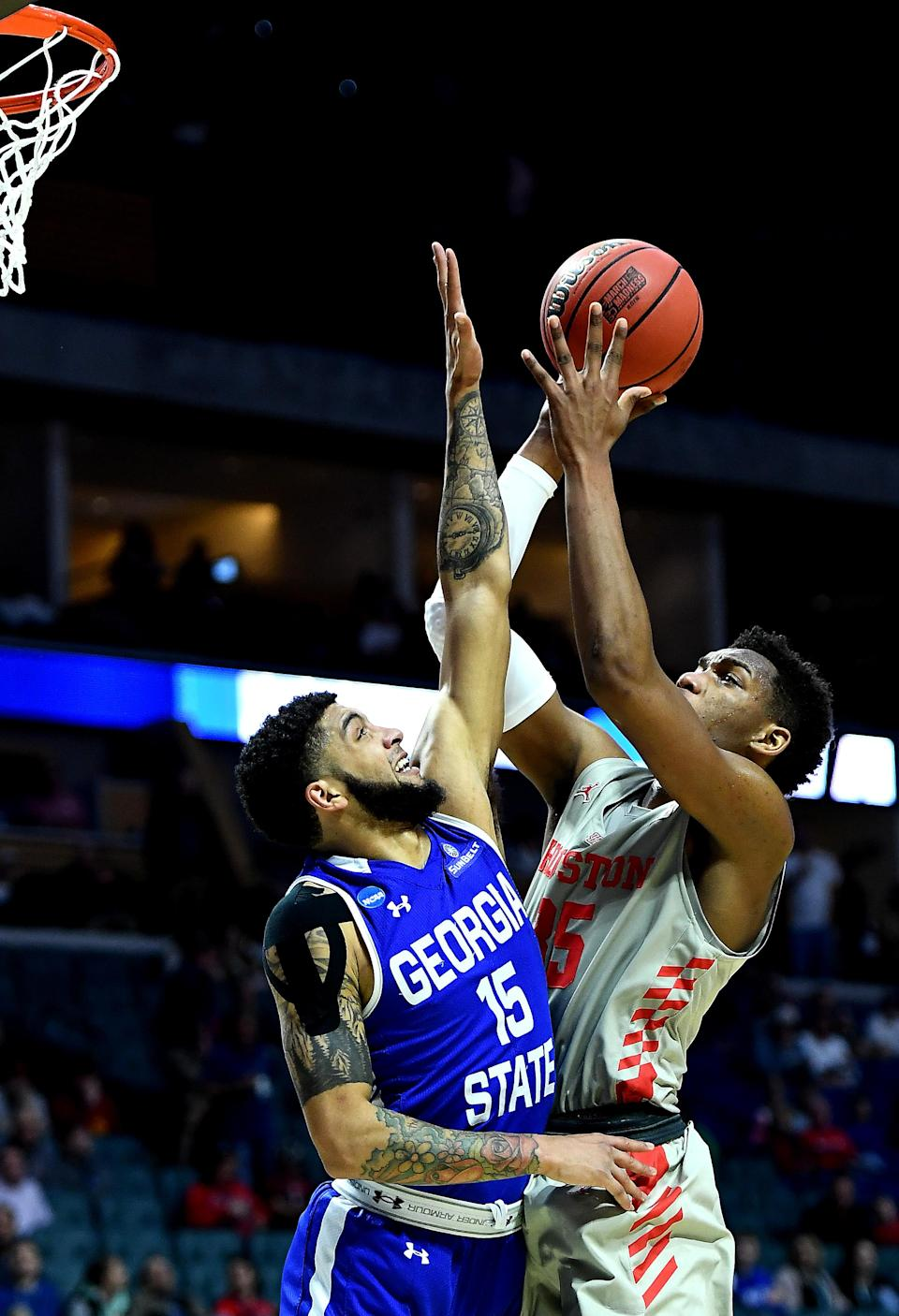 <p>Fabian White Jr. #35 of the Houston Cougars shoots the ball against D'Marcus Simonds #15 of the Georgia State Panthers during the first half in the first round game of the 2019 NCAA Men's Basketball Tournament at BOK Center on March 22, 2019 in Tulsa, Oklahoma. </p>