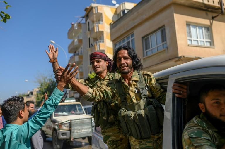 Turkey is relying heavily on Syrian proxies recruited among Sunni Arab former rebels defeated by the Damascus government for its ground operations against the Kurds (AFP Photo/BULENT KILIC)