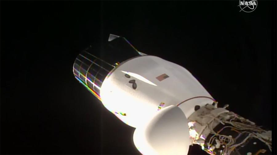 SpaceX's CRS-21 Cargo Dragon is seen docked to a port on the Harmony module of the International Space Station. It's planned return to Earth on Jan. 11, 2021 was delayed by bad weather at its Atlantic Ocean splashdown site.