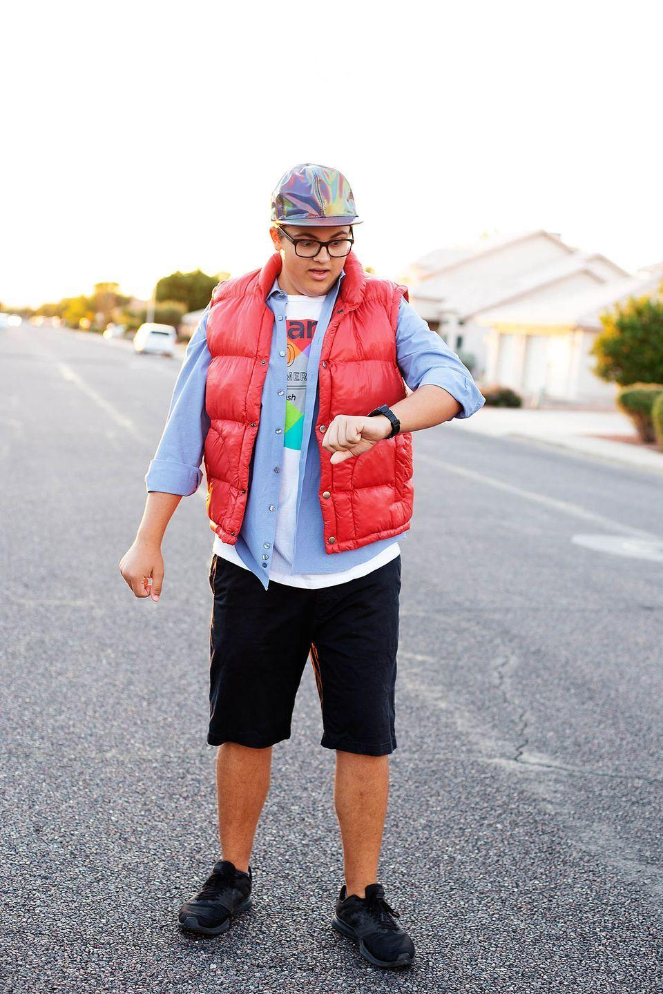"""<p>Hello, McFly! This easy, last-minute <em>Back to the Future</em> costume will have all your friends saying, """"Great Scott!"""" All you'll need to dress as Marty McFly is a red puffer vest, holographic hat, and an '80s calculator watch. Where you're going, you don't need roads!</p><p><strong>See more at <a href=""""https://allfortheboys.com/halloween-costumes-for-teens/"""" rel=""""nofollow noopener"""" target=""""_blank"""" data-ylk=""""slk:All for the Boys"""" class=""""link rapid-noclick-resp"""">All for the Boys</a></strong>. </p><p><a class=""""link rapid-noclick-resp"""" href=""""https://go.redirectingat.com?id=74968X1596630&url=https%3A%2F%2Fwww.walmart.com%2Fip%2FSwissTech-Men-s-and-Big-Men-s-Puffer-Vest-up-to-Size-5XL%2F271288839&sref=https%3A%2F%2Fwww.thepioneerwoman.com%2Fholidays-celebrations%2Fg32645069%2F80s-halloween-costumes%2F"""" rel=""""nofollow noopener"""" target=""""_blank"""" data-ylk=""""slk:SHOP RED PUFFER VEST"""">SHOP RED PUFFER VEST</a></p>"""
