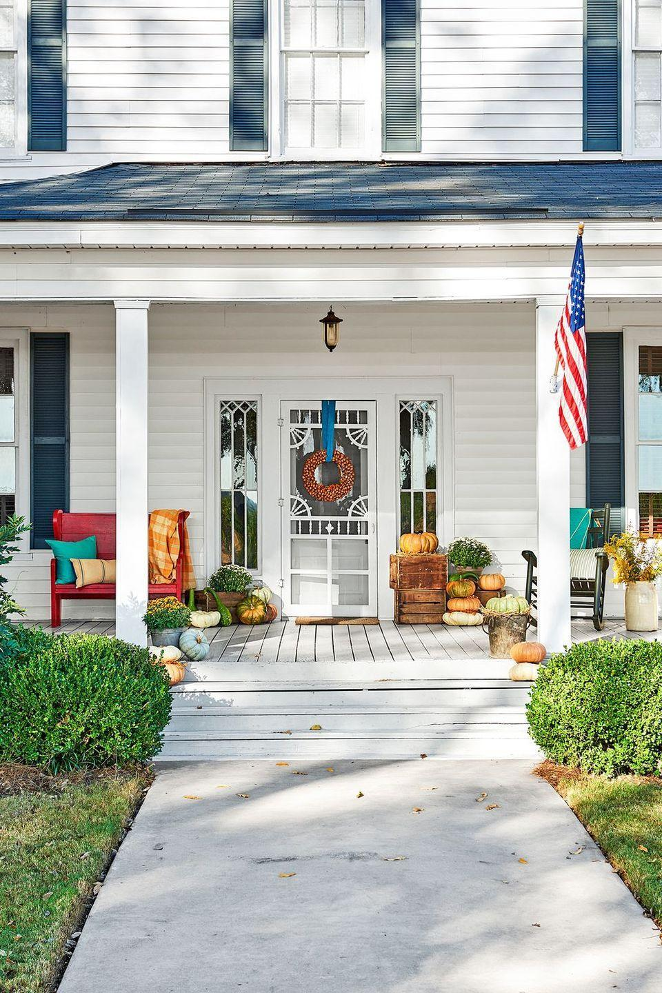 "<p>If you want to take more a general fall approach instead of making your front porch too Halloween-centric, take note from this house at Pearson Farm. Add a ton of pumpkins (bonus points for using apple crates as a pedestal) and then hang your fall wreath with a bright ribbon. </p><p><a class=""link rapid-noclick-resp"" href=""https://www.amazon.com/dp/B07TVHC9L7/ref=sspa_dk_detail_6?tag=syn-yahoo-20&ascsubtag=%5Bartid%7C10057.g.2554%5Bsrc%7Cyahoo-us"" rel=""nofollow noopener"" target=""_blank"" data-ylk=""slk:BUY NOW"">BUY NOW</a> <strong><em>Decorative Fall Crates, $50</em></strong></p>"