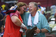 Ryan Crouser, of United States, holds a sign while celebrating winning the gold medal in the final of the men's shot put with his father and coach, Mitch Crouser, at the 2020 Summer Olympics, Thursday, Aug. 5, 2021, in Tokyo, Japan. (Matthias Hangst/Pool Photo via AP)