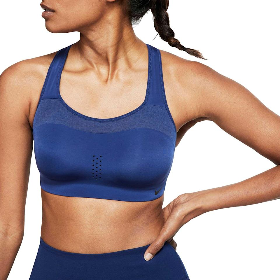 "<p><strong>Nike</strong></p><p>dickssportinggoods.com</p><p><strong>$27.97</strong></p><p><a href=""https://www.dickssportinggoods.com/p/nike-womens-alpha-dri-fit-sports-bra-18nikwlphbrxxxxxxapu/18nikwlphbrxxxxxxapu"" rel=""nofollow noopener"" target=""_blank"" data-ylk=""slk:Shop Now"" class=""link rapid-noclick-resp"">Shop Now</a></p><p>Designed for super-sweaty workouts with molded cups and perforations down the center so you can dry out quickly, this bra lets you take on intensity with ease and comfort. </p><p><strong>Reviewer rave:</strong> ""I own three of these because it's the only sports bra I'll wear while running, HIIT, cardio, or any kind of workout that's medium-high impact. It actually holds me in place. I'm a 32DD so I wear an S (D-E). the sizing is perfect for women of all different sizes. It's not just S, M, L... it actually accounts for cup sizes."" <em>—emvee, nike.com</em></p>"