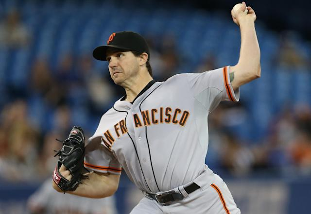 TORONTO, CANADA - MAY 14: Barry Zito #75 of the San Francisco Giants delivers a pitch during MLB game action against the Toronto Blue Jays on May 14, 2013 at Rogers Centre in Toronto, Ontario, Canada. (Photo by Tom Szczerbowski/Getty Images)