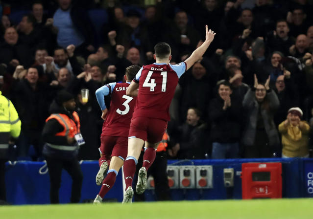 West Ham's Aaron Cresswell celebrates scoring West Hams first goal during the English Premier League soccer match between Chelsea and West Ham at Stamford Bridge Stadium in Lonodn, England, in London, England, Saturday, Nov. 30, 2019. (AP Photo/Leila Coker)