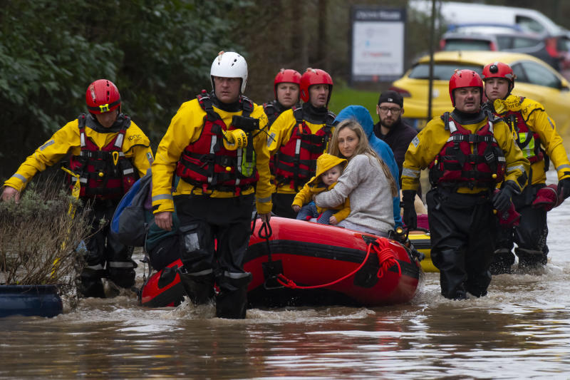 NANTGARW, UNITED KINGDOM - FEBRUARY 16: A family is rescued from a property on Oxford Street on February 16, 2020 in Nantgarw, Wales. The Met Office has issued a red weather warning for rain in Wales and a yellow weather warning for wind for large parts of the UK as storm Dennis passes over the UK. Last week two people were killed as storm Ciara saw parts of the country hit by 93mph winds. (Photo by Matthew Horwood/Getty Images)