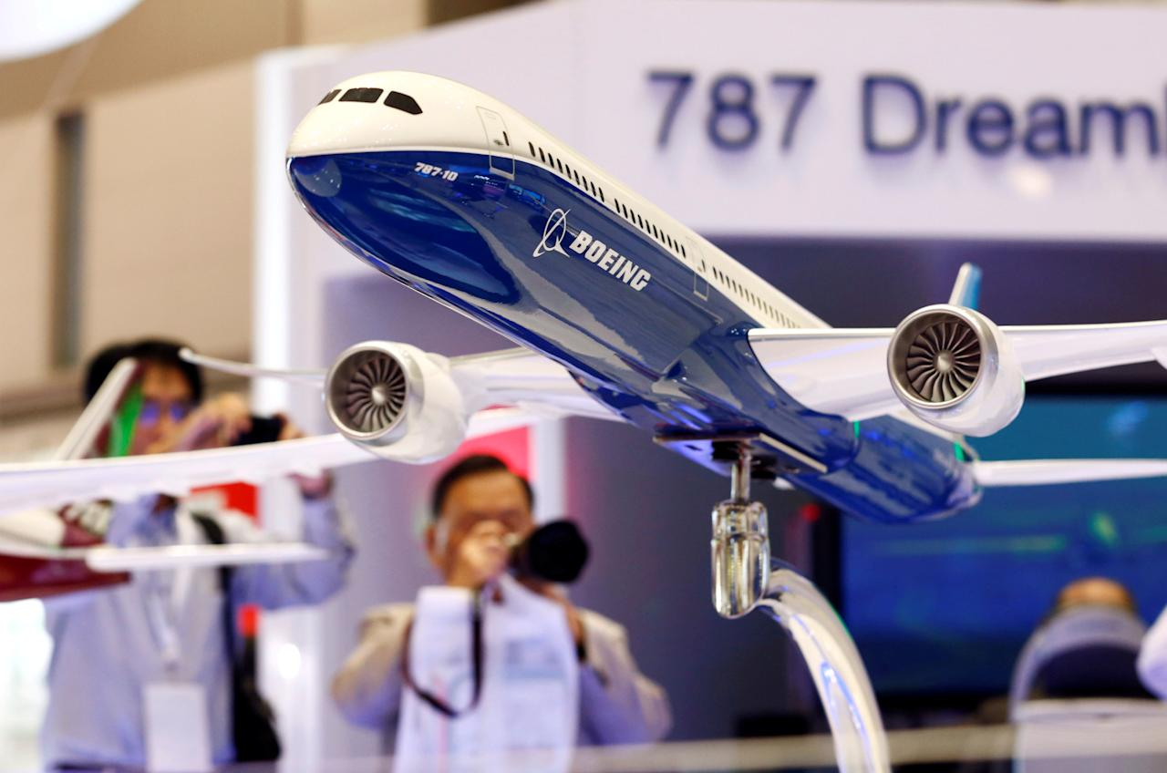 FILE PHOTO: Visitors take pictures of a model of Boeing's 787 Dreamliner during Japan Aerospace 2016 air show in Tokyo, Japan, October 12, 2016.   REUTERS/Kim Kyung-Hoon/File Photo