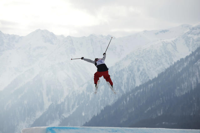 Devin Logan of the United States takes a jump during the women's freestyle skiing slopestyle qualifying at the Rosa Khutor Extreme Park, at the 2014 Winter Olympics, Tuesday, Feb. 11, 2014, in Krasnaya Polyana, Russia. (AP Photo/Jae C. Hong)