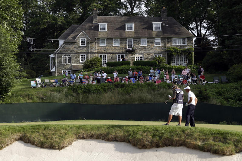 Nicolas Colsaerts, of Belgium, waits to putt on the 11th hole during the third round of the U.S. Open golf tournament at Merion Golf Club, Saturday, June 15, 2013, in Ardmore, Pa. (AP Photo/Gene J. Puskar)