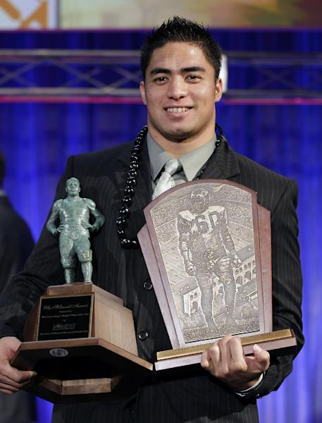 Notre Dame defensive back Manti Te'o displays his trophyies after being named the college defensive player of the year and the nation's college player of the year at the Home Depot College Football Awards in Lake Buena Vista, Fla., Thursday, Dec. 6, 2012. (AP Photo/John Raoux)