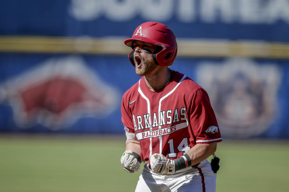 Arkansas' Cullen Smith celebrates after hitting a two-run home run against Tennessee in the eighth inning of an NCAA college baseball championship game during the Southeastern Conference tournament Sunday, May 30, 2021, in Hoover, Ala. (AP Photo/Butch Dill)