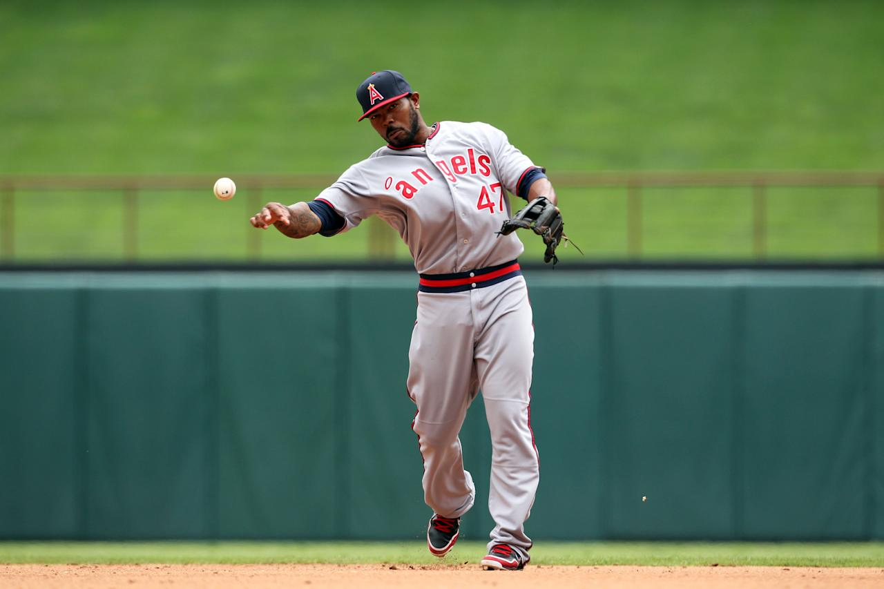 ARLINGTON, TX - MAY 12: Howie Kendrick #47 of the Los Angeles Angels of Anaheim throws out a Texas Rangers runner on May 12, 2012 in Arlington, Texas. (Photo by Layne Murdoch/Getty Images)