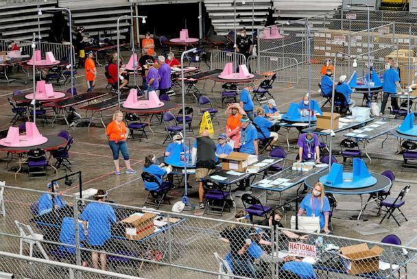 PHOTO: Maricopa County ballots cast in the 2020 general election are examined and recounted by contractors working for Florida-based company, Cyber Ninjas, at Veterans Memorial Coliseum in Phoenix, May 6, 2021. (Matt York/AP, FILE)