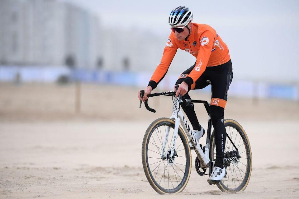 Dutch cyclist Mathieu Van Der Poel rides on a beach during a track reconnaissance and training session ahead of the world championships cyclocross cycling in Oostende on January 28 2021  The worlds are taking place on January 30 and 31 Photo by DAVID STOCKMAN  Belga  AFP  Belgium OUT Photo by DAVID STOCKMANBelgaAFP via Getty Images