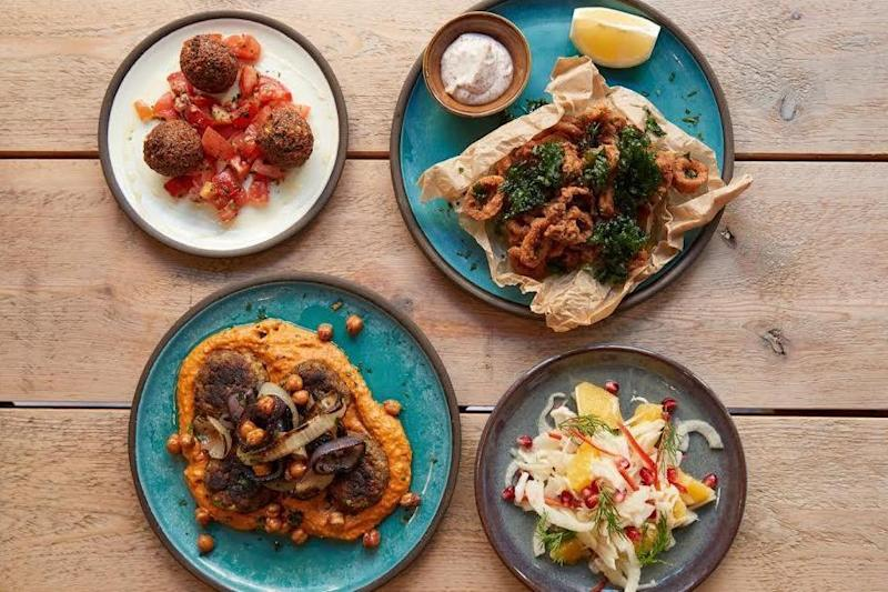 Shoreditch small plates: Dishes at Strut & Cluck, including calamari and feta fritters