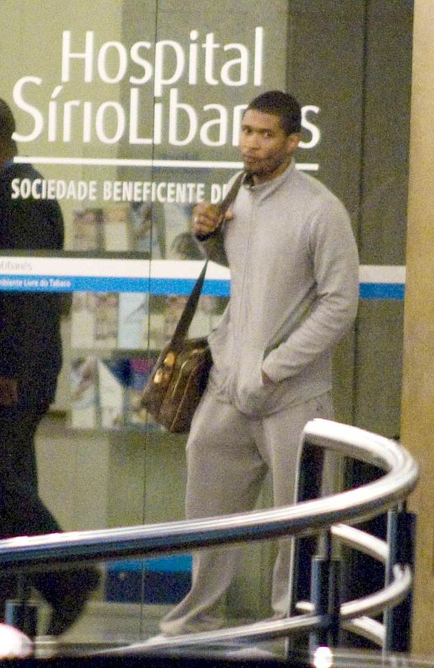 "Usher was seen leaving the Sirio Libanez hospital where his wife Tameka Foster was recovering from a heart attack suffered shortly before undergoing plastic surgery. Tameka was released from the facility Monday evening. <a href=""http://www.infdaily.com"" target=""new"">INFDaily.com</a> - February 14, 2009"