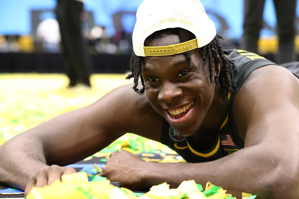 INDIANAPOLIS, INDIANA - APRIL 05: Jonathan Tchamwa Tchatchoua #23 of the Baylor Bears plays in the confetti after his team's win against the Gonzaga Bulldogs in the National Championship game of the 2021 NCAA Men's Basketball Tournament at Lucas Oil Stadium on April 05, 2021 in Indianapolis, Indiana. (Photo by Jamie Schwaberow/NCAA Photos via Getty Images)