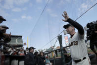 San Francisco Giants manager Bruce Bochy waves to fans as he exits the field during a ceremony honoring Bochy after a baseball game between the Giants and the Los Angeles Dodgers in San Francisco, Sunday, Sept. 29, 2019. (AP Photo/Jeff Chiu, Pool)